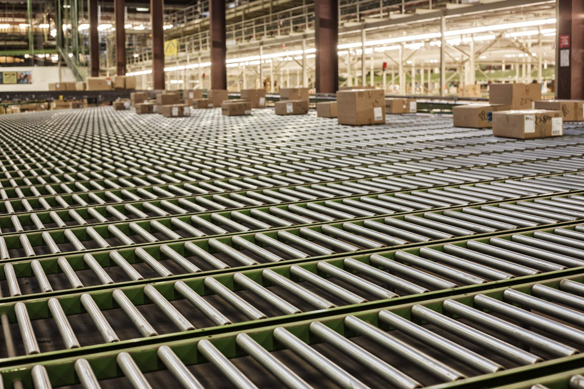 Interior view of a gravity feed conveyor system in a large distribution warehouse with products