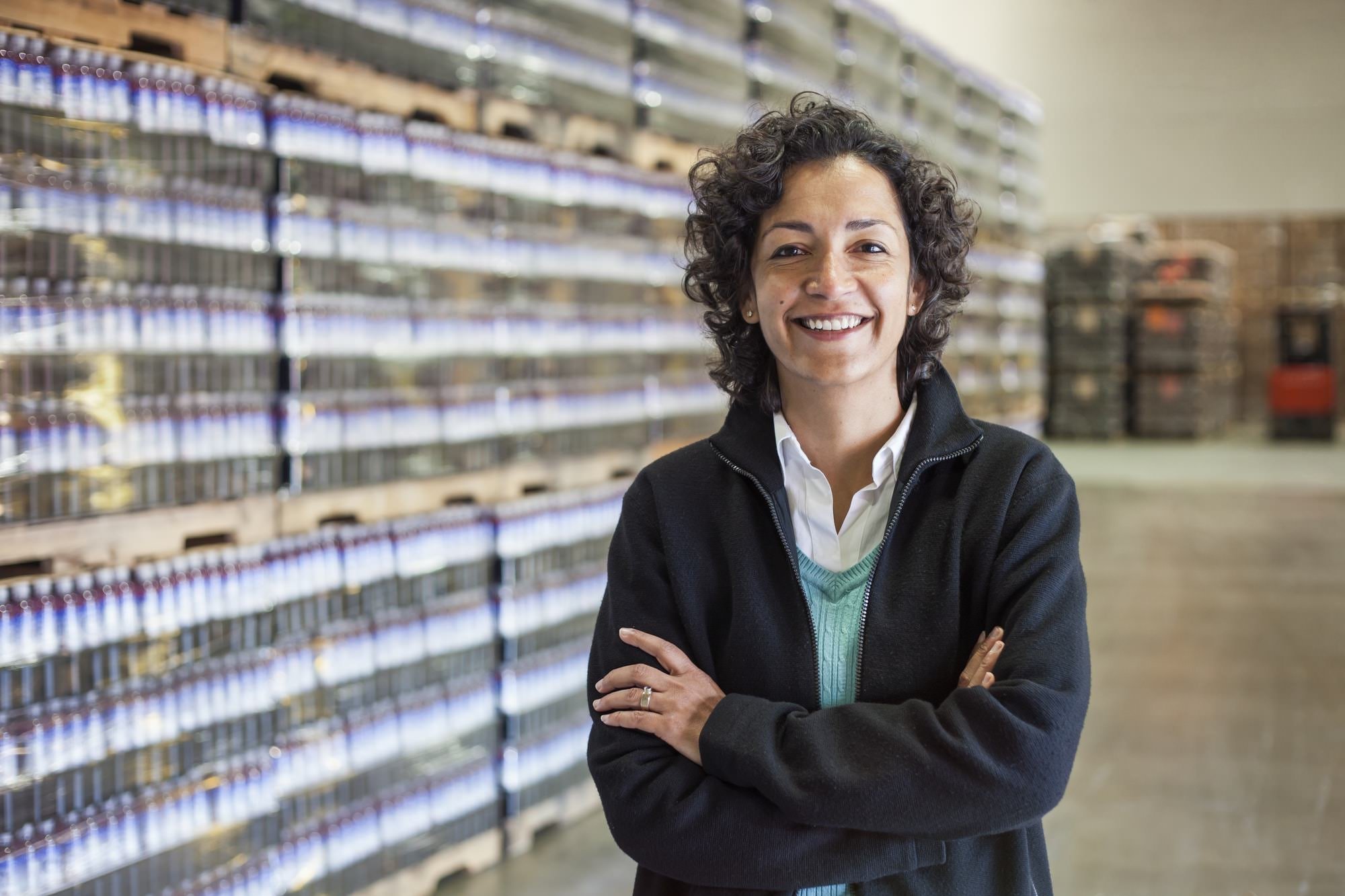 Portrait of an African American female manager in a storage warehouse of pallets